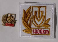 Picture of the pin and patch for 1,000 Kilometers