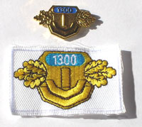 Picture of the pin and patch for 1,300 Events