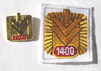 Picture of the pin and patch for 1,400 Events