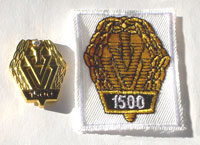 Picture of the pin and patch for 1,500 Events